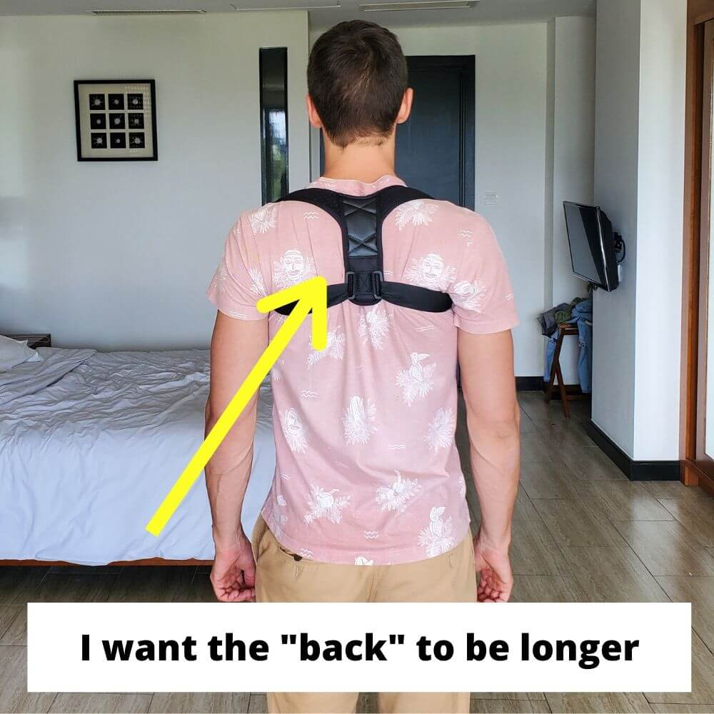 a young man is wearing one of the best posture correctors facing the camera with his back